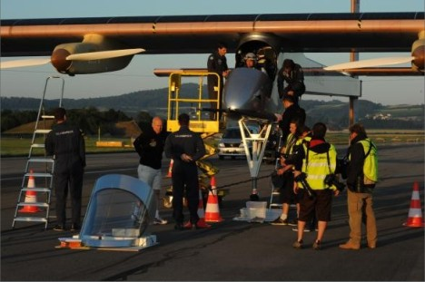 close up of Solar Impulse on the ground with maintenance crew