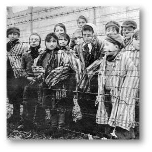 children prisoners of a concentration camp behind barbed wire fence
