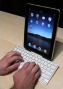 Someone using an external keyboard to type on an iPad