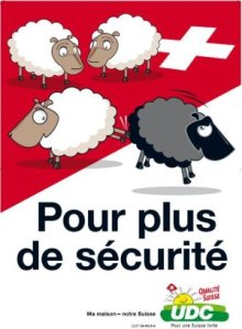 "3 white sheep on a Swiss flag, kicking out a black sheep, with the slogan ""Pour plus de sécurité"" and the logo of the UDC party"