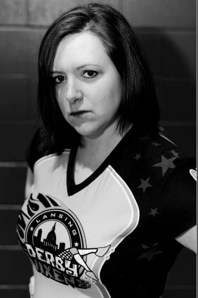 Addie Mortem (Jess Knott), blocker for the Lansing Derby Vixens. Photo by Jena McShane of McShane Photography.