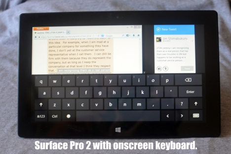 Surface Pro 2 with the on-screen keyboard over the LMS and Twitter.
