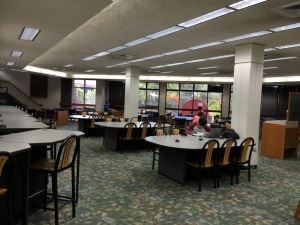Students use their own notebooks on study tables. The entire library is a hot zone.